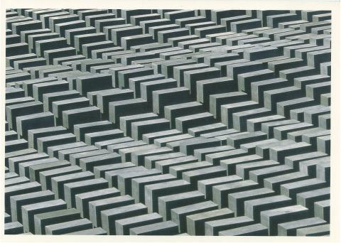 Holocaust memorial in Berlin, Germany. Grey stone blocks placed in geometric patterns.