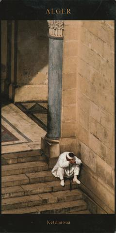 A man resting on his cane in the stairs, in Ketchaoua mosque in Algiers.